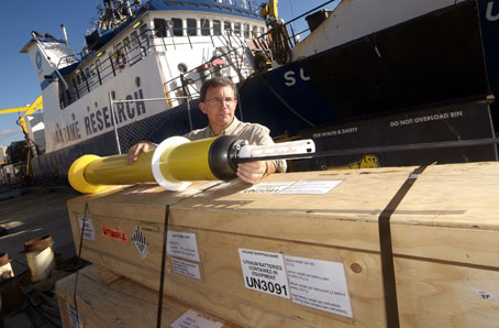 Dr Steve Rintoul holds an Argo robotic profiler, which will be joining over 3000 others already at sea informing science about ocean temperature, salinity and circulation.  PHOTO BRUCE MILLER