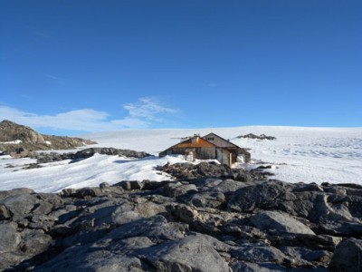 Antarctica's vast ice plateau looms behind Douglas Mawson's 1912 expedition headquarters.