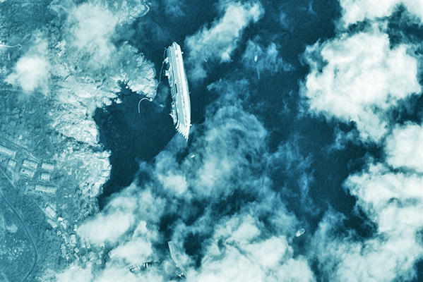 A satellite view of Costa Concordia on the rocks of Isola del Giglio, Italy. SOURCE DIGITAL GLOBE