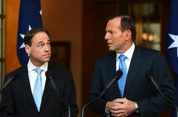 Greg Hunt and Tony Abbott at a Parliament House press conference following the repeal of the carbon tax legislation. PHOTO AAP/Lukas Coch