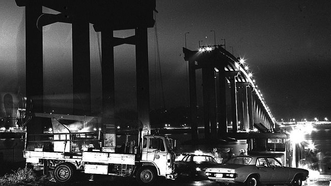 A non-negotiable event: the broken Tasman Bridge on the night of the disaster, 5 January 1975. PHOTO Don Stephens, Mercury