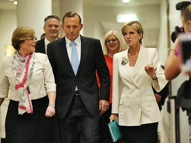 Tony Abbott and colleagues approach the party room ahead of the spill vote. PHOTO Craig Greenhill/New Corp Australia