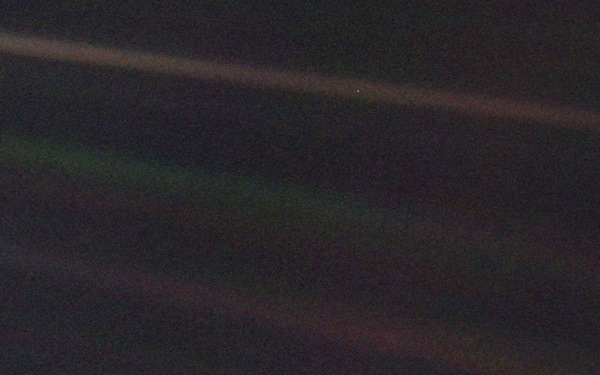 The inner solar system as seen from Voyager 1 on 14 February 1990. Earth is the pale dot in the top coloured band, towards the right of the picture. PHOTO NASA