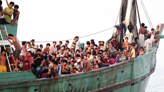Rohingyas and Bangladeshi migrants on a fishing boat off the coast of Julok, Indonesia, last week. PHOTO Reuters
