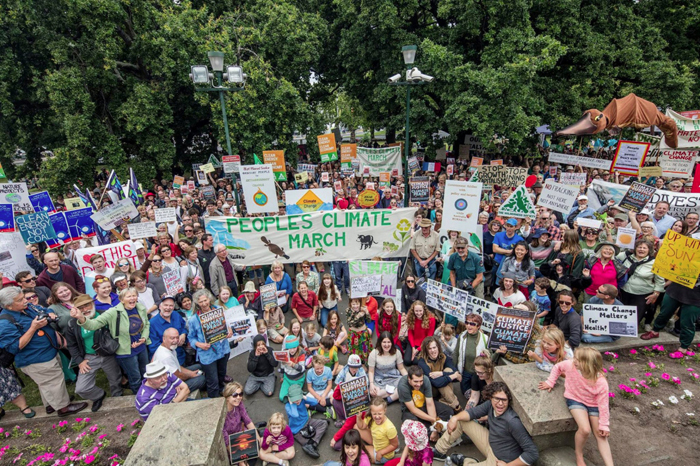 Thousands rallied on Hobart's Parliament Lawns in support of strong climate decisions in Paris. PHOTO Rob Blakers