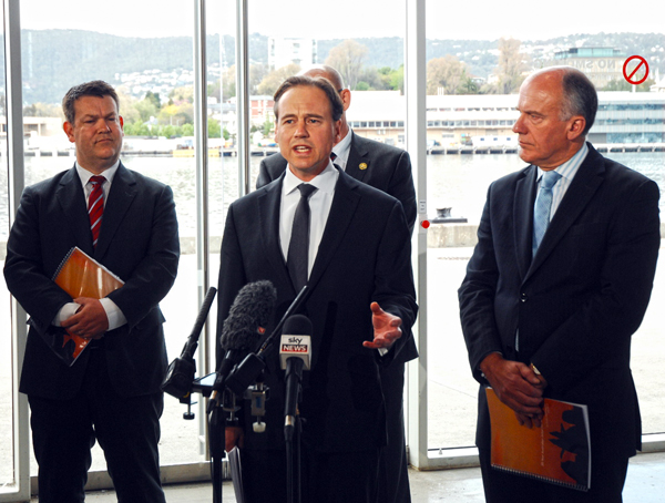 Matthew Groom (left) at the launch of the Australian Antarctic Strategic Plan released by federal environment minister Greg Hunt (centre) and Tasmanian senator Eric Abetz last year. PHOTO AAP/Andrew Drummond