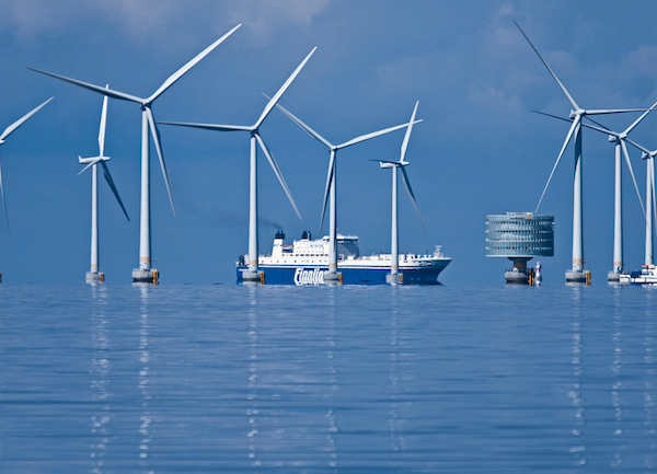 A freighter passes through the Swedish Lillgrund wind farm, an average-sized 110-megawatt offshore facility in the Baltic Sea. Since 2008 the farm's 48 turbines have provided enough power for 60,000 households. The circular substation houses an offshore transformer which bundles the power from the turbines for dispatch to the national grid. PHOTO Siemens