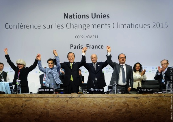 UN and French leaders celebrate adoption of the Paris agreement, 12 December 2015. PHOTO Arnaud Bouissou