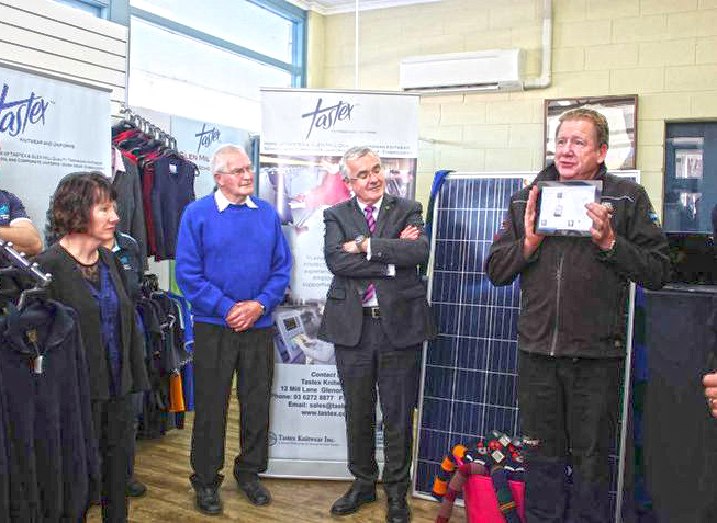 Rob Manson of I Want Energy explains the finer points of solar power, watched by (left to right) Tastex executive officer Vicki Hawker, chairman Maurie Harris, and Andrew Wilkie MP, who launched the solar project last month. PHOTO Tastex