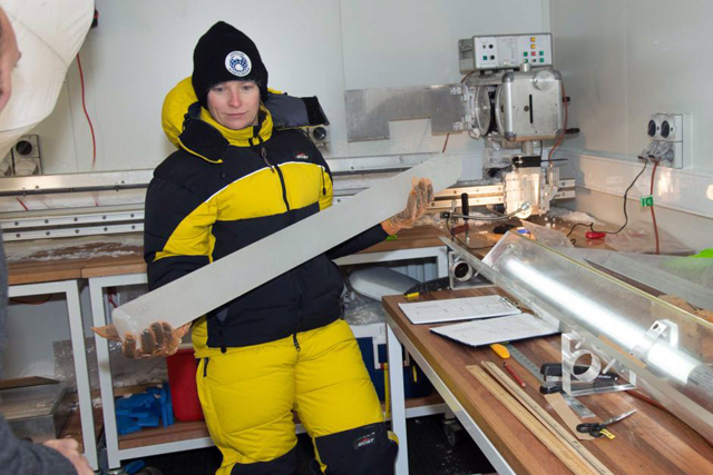 ACE-CRC glaciologist Tessa Vance holds a drill core of ancient Antarctic ice, which has much to tell us about Australia's evolving climate. PHOTO ABC