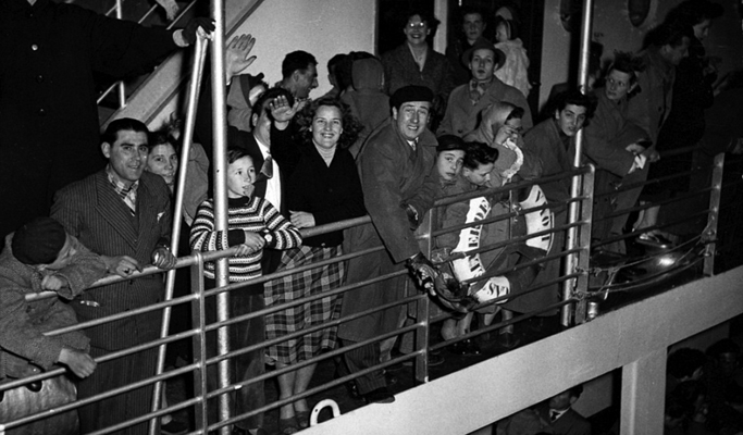 Refugees fleeing war-ravaged Europe arrive by ship in Australia after World War II. PHOTO Keith Woodward/Australian National Maritime Museum