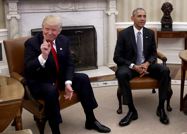 President-elect Donald Trump, left, talks after a meeting with U.S. President Barack Obama, right, in the Oval Office on Thursday. PHOTO Win McNamee/Getty Images