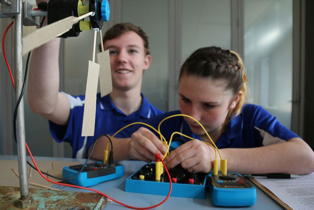 Toby Thorpe (left) and Zephryn Fox at work on a renewable energy project. PHOTO ABC