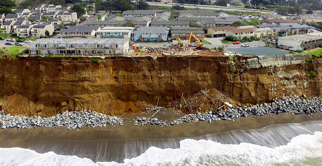Coastal erosion, Pacifica, California. The apartment block was subsequently demolished. PHOTO Terry Chea/Associated Press