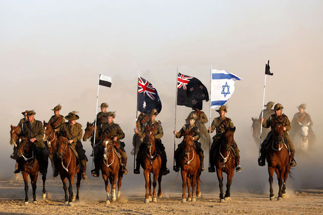 The Israeli flag flies alongside those of Australia and New Zealand in the re-enacted advance on Beersheba on 31 October. PHOTO Abir Sultan, European Pressphoto Agency