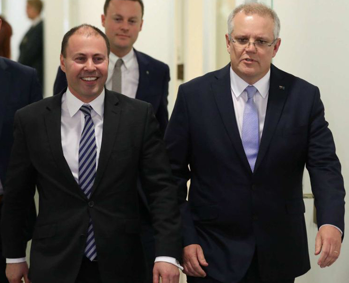 New treasurer-to-be Josh Frydenberg can scarcely believe his good fortune as he leaves the Liberal party room with PM-designate Scott Morrison.