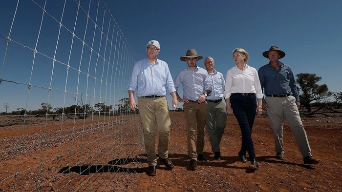 Scott Morrison and entourage on the ground near Quilpie. PHOTO SBS