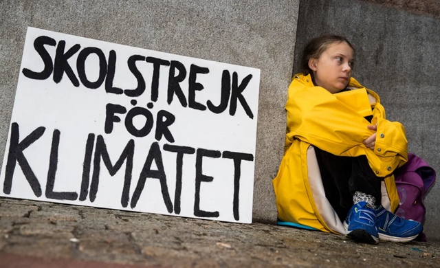 Greta Thunberg, 15, outside the Swedish Parliament last August in her protest politicians' failure to act on climate change. PHOTO Michael Campanella / Guardian